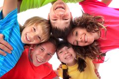 Happy brothers and sisters. An attractive group of smiling brothers and sisters happy to be together Royalty Free Stock Images