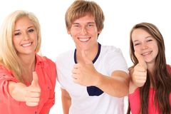 Happy brothers and sisters. Happy young brother and two sisters with thumbs up, white background royalty free stock images