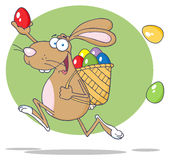 Happy brown easter rabbit running with a basket Stock Image