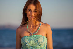 Happy brunette at the beach Royalty Free Stock Image