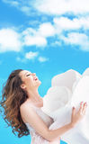 Happy brunette beauty over sky background Stock Photo