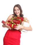 Happy brunette with boxed gifts in her hand Stock Photography