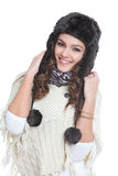 Happy brunette with fur hat. On isolated white background Stock Photo