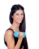 Happy brunette girl with blue dumbbells Stock Photography