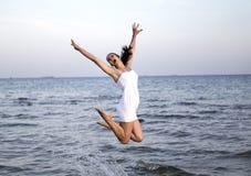 Happy brunette girl jumping Stock Photos