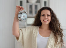 Happy brunette girl looks at his watch Royalty Free Stock Image