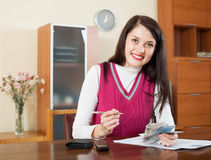 Happy brunette girl with money and documents Royalty Free Stock Image