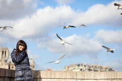 Happy brunette girl in Paris at windy spring day Royalty Free Stock Photos