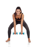 Happy brunette girl toning her muscles Stock Image