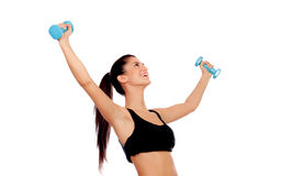 Happy brunette girl toning the muscles Royalty Free Stock Photography