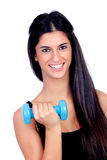 Happy brunette girl toning the muscles Stock Image