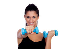 Happy brunette girl toning the muscles Stock Photo