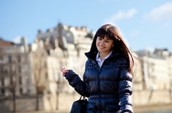 Happy brunette girl walking at Parisian embankment Stock Photos