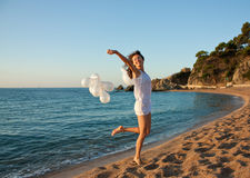 Happy brunette girl with white balloons Royalty Free Stock Photography