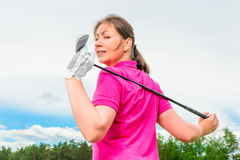 Happy brunette on the golf course Stock Photos