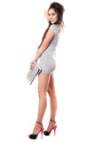 Happy brunette in gray dress Stock Photo