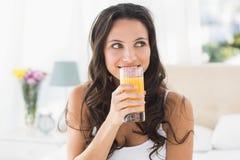 Happy brunette having glass of orange Royalty Free Stock Photos