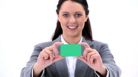 Happy brunette holding a business card Royalty Free Stock Photography