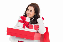 Happy brunette holding christmas gifts and shopping bags Royalty Free Stock Image