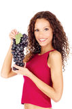 Happy brunette holding grape Royalty Free Stock Photography