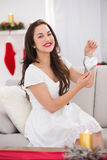 Happy brunette holding heart for decoration Royalty Free Stock Photos