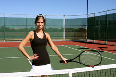 Happy Brunette holding her racquet. Pretty Brunette woman holding her racquet on the court Royalty Free Stock Photo