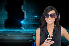 Happy brunette holding smartphone Royalty Free Stock Photo