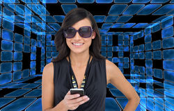 Happy brunette holding smartphone Stock Photo