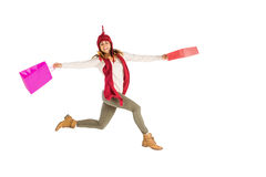 Happy brunette jumping with gifts bags Stock Photography