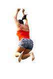 Happy brunette jumping over white background Stock Images