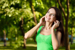 Happy brunette listening music Royalty Free Stock Images