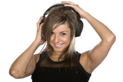 Happy Brunette Listening to Headphones Stock Photography