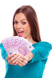 Happy brunette with money Stock Images