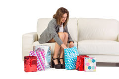 Happy brunette opening gift bag Royalty Free Stock Photography