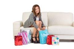 Happy brunette opening gift bag Stock Images