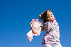 Happy brunette playing with a scarf in the summer Stock Image