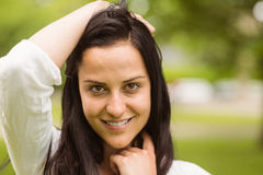 Happy brunette posing and looking at camera Royalty Free Stock Photo