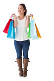 Happy brunette posing with shopping bags Royalty Free Stock Photos