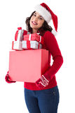 Happy brunette in santa hat holding many gifts Stock Photo