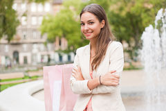 Happy brunette shopper. Royalty Free Stock Photo
