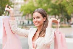 Happy brunette shopper. Stock Photography