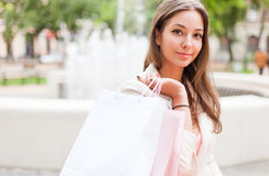Happy brunette shopper. Royalty Free Stock Photos