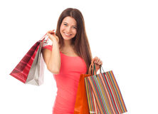 Happy brunette with shopping bags Royalty Free Stock Photography