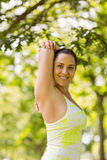 Happy brunette in sportswear stretching Royalty Free Stock Image