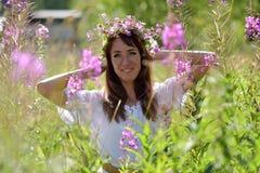 Happy brunette in a summer field Stock Photos