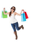 Happy brunette with sunglasses holding shopping bags Royalty Free Stock Photography