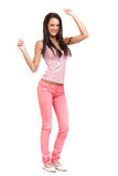Happy brunette teenager dancing isolated on white Royalty Free Stock Photography