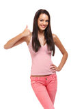 Happy brunette teenager with thumb up Stock Image