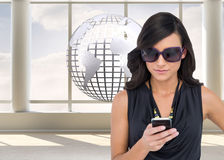 Happy brunette using smartphone Stock Images