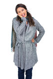 Happy brunette wearing winter clothes posing Royalty Free Stock Photography